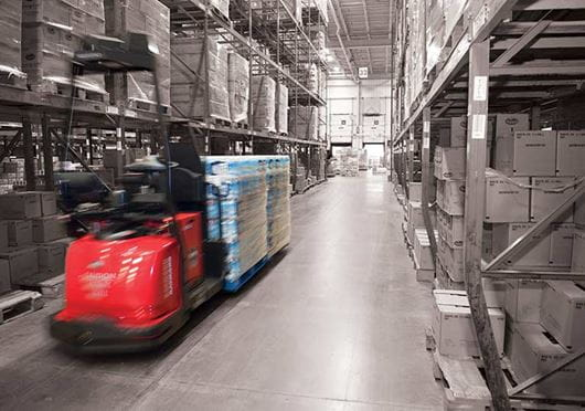 Raymond Courier Automated Lift Truck in Warehouse Aisle