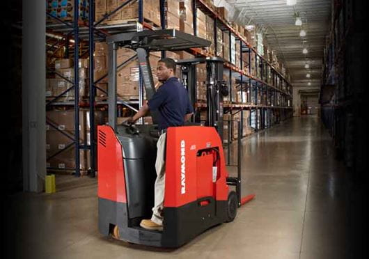 Raymond 4250 Stand Up Counterbalanced Truck Driving in Aisle
