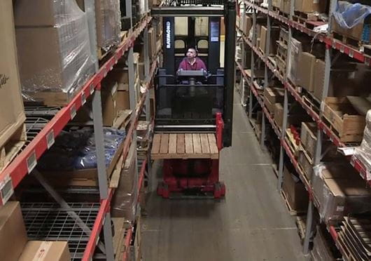 Raymond 9800 Swing Reach Truck in Aisle